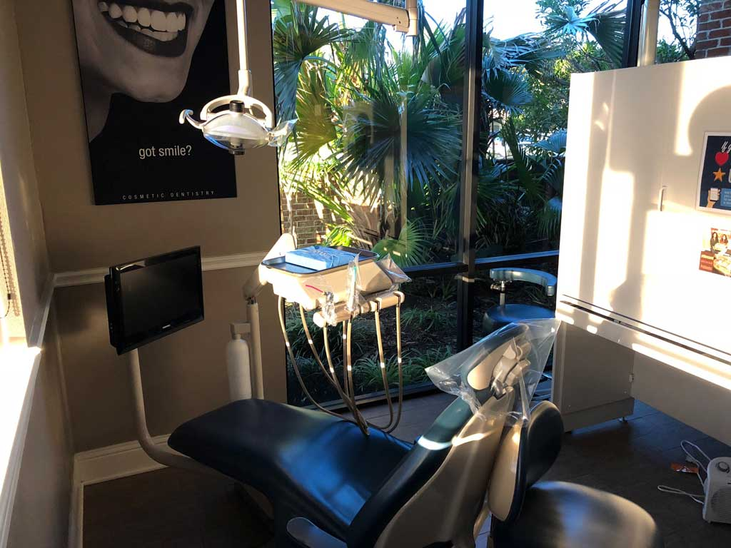 Operatory with dental chair and equipment at McDonald Dental in Houston, TX.