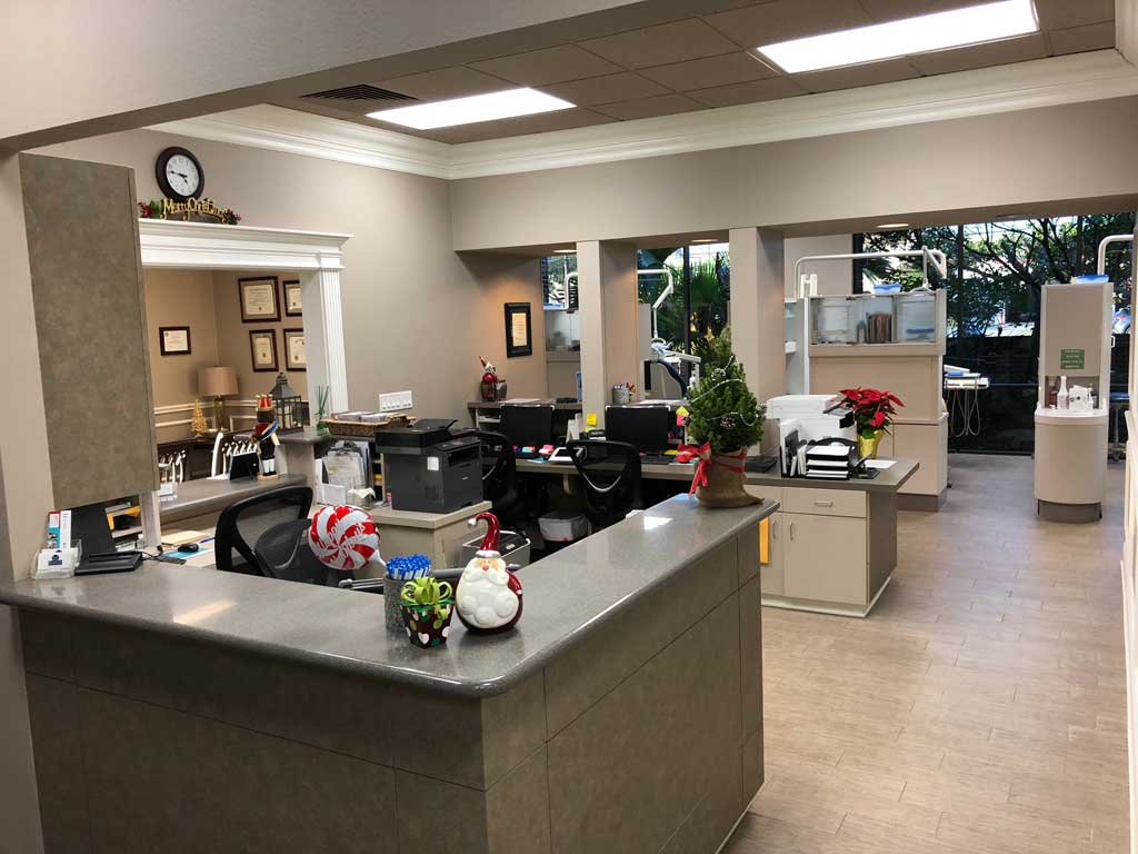 Reception area with operatories in the back at McDonald Dental in Houston, TX.