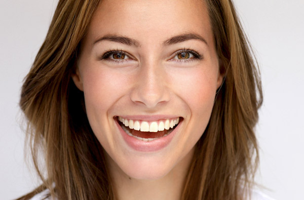 Beautiful woman smiling after cosmetic dental treatment from McDonald Dental in Houston, TX